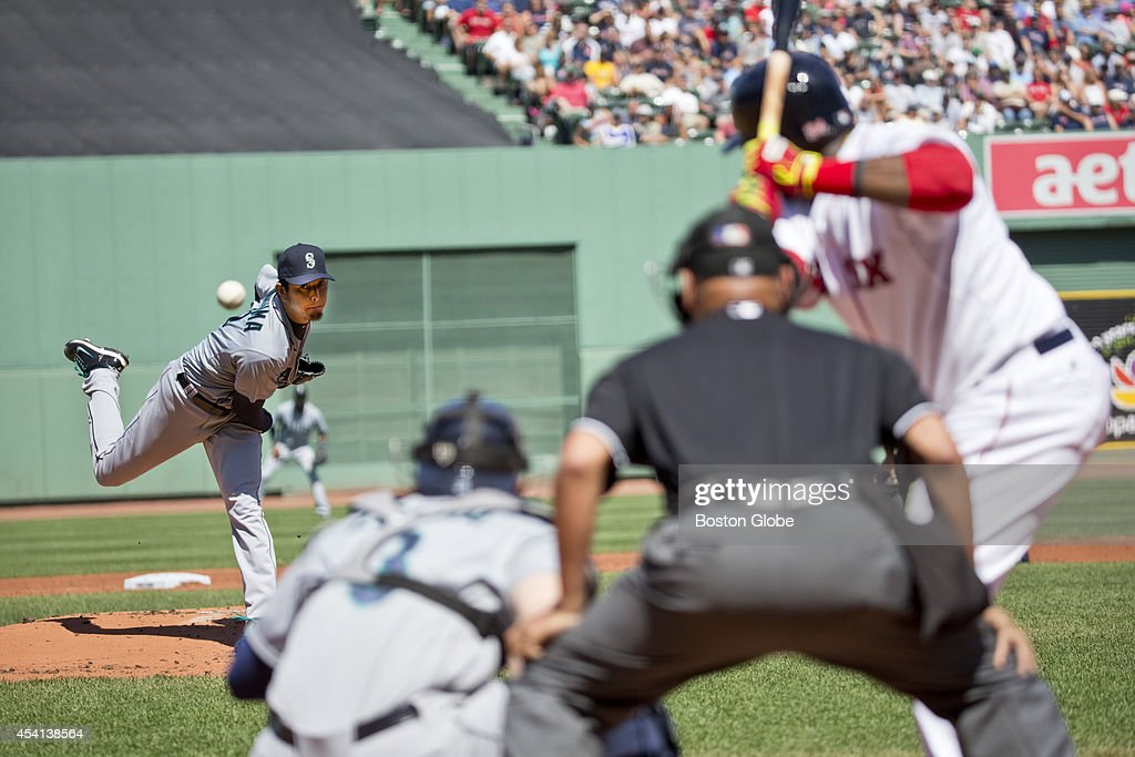 Seattle Mariners starting pitcher Hisashi Iwakuma delivers a pitch to Boston Red Sox David Ortiz during first inning action at Fenway Park on Sunday, August 24, 2014.