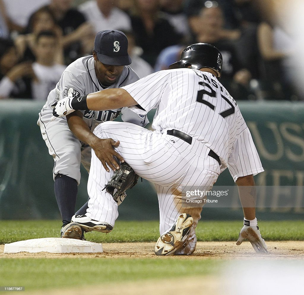Seattle Mariners third baseman Chone Figgins (9) tagged out Chicago White Sox catcher Ramon Castro (27) is out at third base during the seventh inning at U. S. Cellular Field in Chicago, Illinois, on Wednesday June 8, 2011.