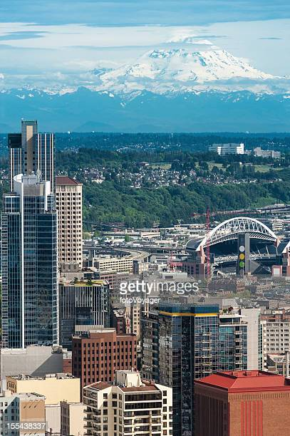 Seattle Mt Rainier towering over downtown skyscrapers stadiums