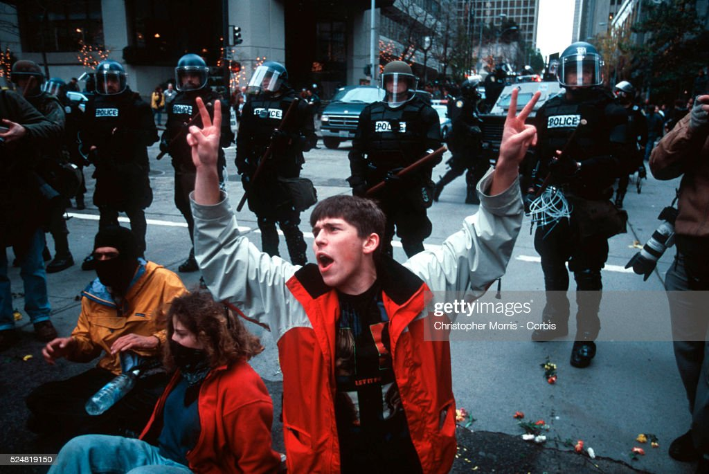 Seattle police in riot gear maintain order during protest by various labor and environmental groups against the World Trade Organization meetings