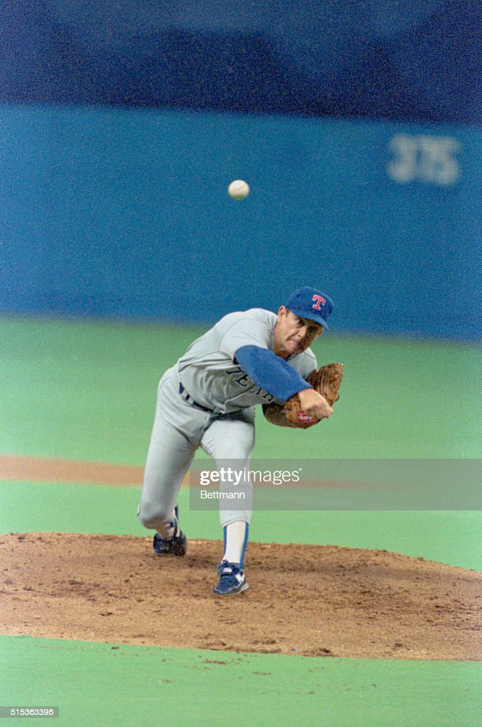 Rangers pitcher <a gi-track='captionPersonalityLinkClicked' href=/galleries/search?phrase=Nolan+Ryan&family=editorial&specificpeople=202212 ng-click='$event.stopPropagation()'>Nolan Ryan</a> throws to the plate against the Mariners at the Kingdome.