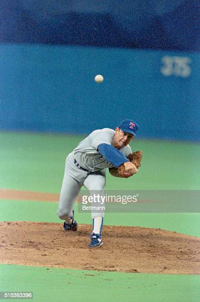 Rangers pitcher Nolan Ryan throws to the plate against the Mariners at the Kingdome