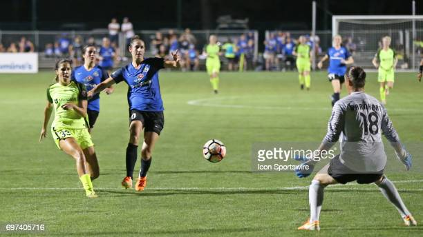 Seattle Reign FC forward Katlyn Johnson takes a shot that is blocked by FC Kansas City goalkeeper Nicole Barnhart in the second half of an NWSL match...