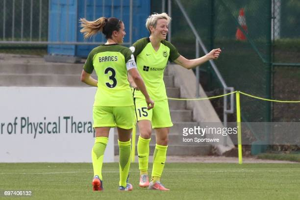 Seattle Reign FC forward Megan Rapinoe celebrates her first half goal with defender Lauren Barnes in an NWSL match between the Seattle Reign FC and...