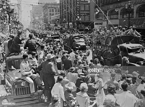 Seattle responded with another heartwarming welcome this afternoon as 1291 fighting men from Korea rode up Second Avenue after they trooped down the...