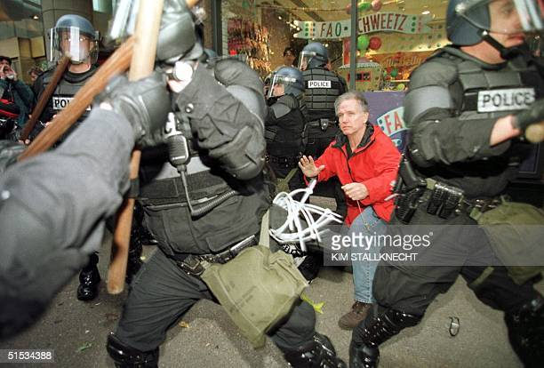 Seattle riot police scuffle with World Trade Organization protesters as they make arrests during the second day of demonstrations against the WTO...