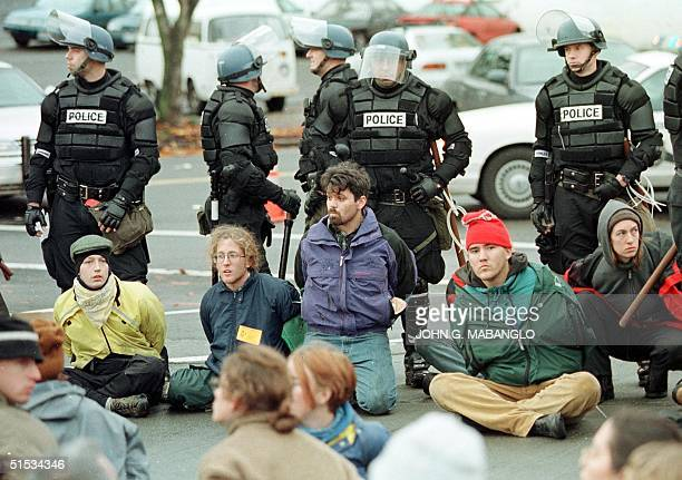 Seattle riot police stand guard after arresting more than a dozen antiWTO protesters 01 December 1999 in Seattle WA The protesters were arrested as...