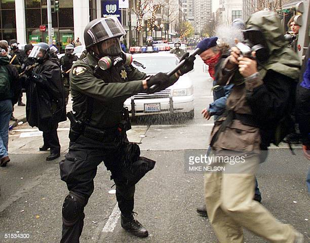 Seattle riot policeman clashes with demonstrators in front of the Washington State Convention Center where the opening ceremony of the World Trade...