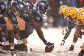 Seattle Seahawks center Chris Spencer snaps ball at line of scrimmage during 3424 victory over the Green Bay Packers in ESPN Monday Night Football...