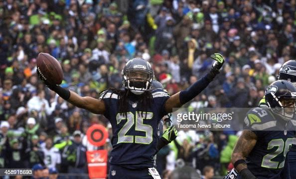 Seattle Seahawks corner back Richard Sherman celebrates after intercepting a pass by Arizona Cardinals quarterback Carson Palmer at CenturyLink Field...