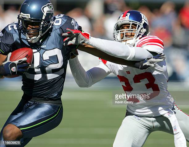 Seattle Seahawks Darrell Jackson makes a catch as New York Giants Corey Webster closes in to make the stop at Qwest Field in Seattle Washington...