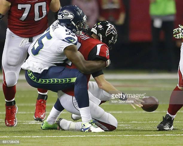 Seattle Seahawks defensive end Frank Clark sacks Atlanta Falcons quarterback Matt Ryan in the second half of the NFC Divisional Playoff game between...