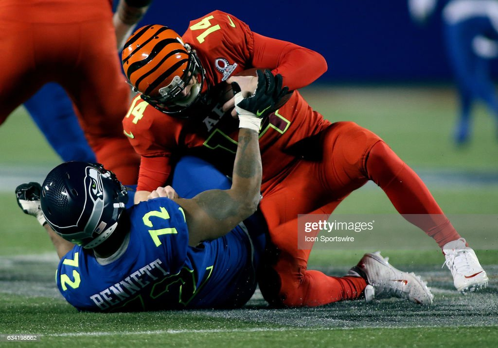 Seattle Seahawks defensive end Michael Bennett (72) takes down Cincinnati Bengals quarterback Andy Dalton (14) for a sack during the 2017 Pro Bowl at Camping World Stadium in Orlando, Florida.