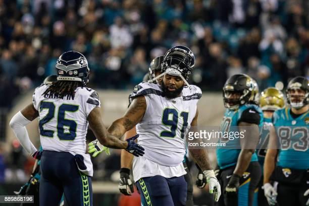 Seattle Seahawks defensive lineman Sheldon Richardson walks off the field following an ejection during the game between the Seattle Seahawks and the...