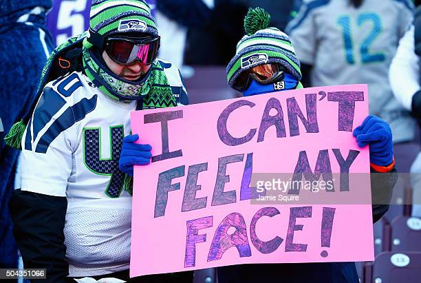 Seattle Seahawks fan holds a sign during the NFC Wild Card Playoff game between the Minnesota Vikings and the Seattle Seahawks at TCFBank Stadium on...