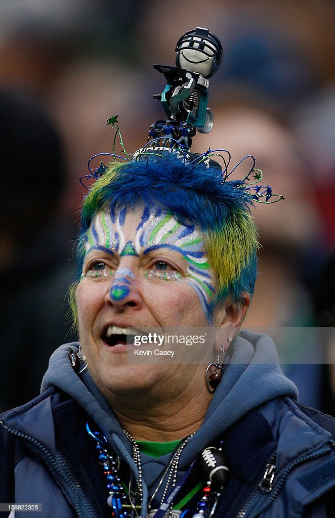 A Seattle Seahawks fan with a bobble head on top of her head against the St. Louis Rams at CenturyLink Field on December 30, 2012 in Seattle, Washington.