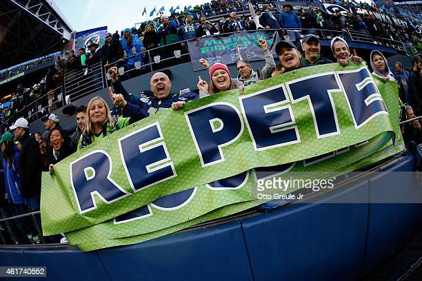 Seattle Seahawks fans celebrate during the second half of the 2015 NFC Championship game against the Green Bay Packers at CenturyLink Field on...