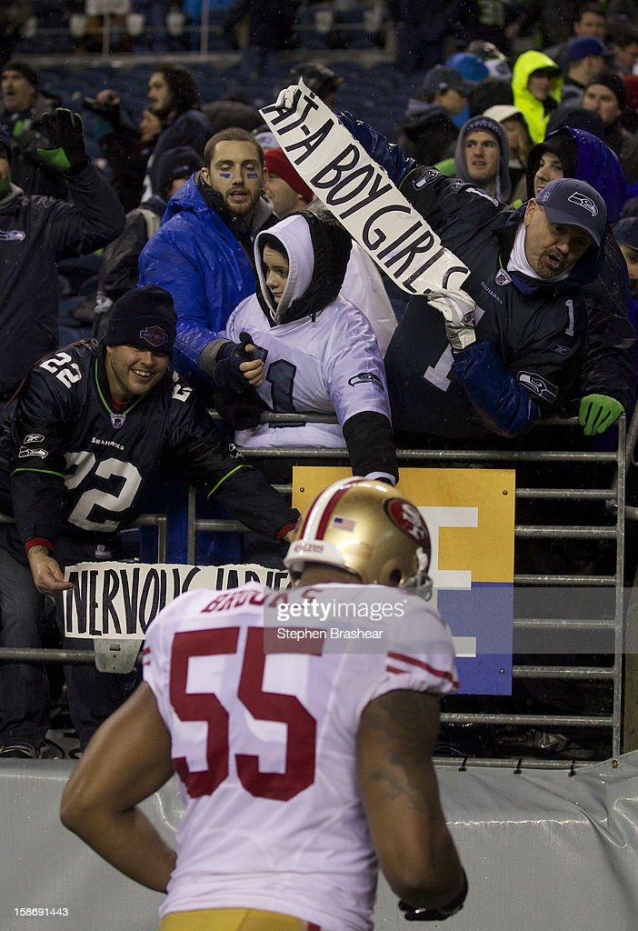 Seattle Seahawks fans taunt <a gi-track='captionPersonalityLinkClicked' href=/galleries/search?phrase=Ahmad+Brooks&family=editorial&specificpeople=2326499 ng-click='$event.stopPropagation()'>Ahmad Brooks</a> #55 of the San Francisco 49ers after a game at CenturyLink Field on December 23, 2012 in Seattle, Washington. The Seahawks won the game 42-13.