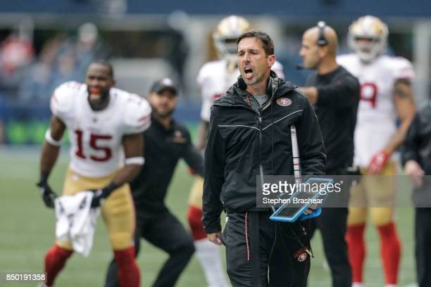 Seattle Seahawks head coach Kyle Shanahan yells as he walks down the sideline during a game against the Seattle Seahawks at CenturyLink Field on...