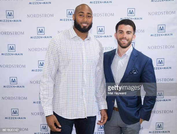 Seattle Seahawks linebacker KJ Wright and men's clothing line MizzenMain founder Kevin Lavelle pose for a photo during a MizzenMain promotional event...