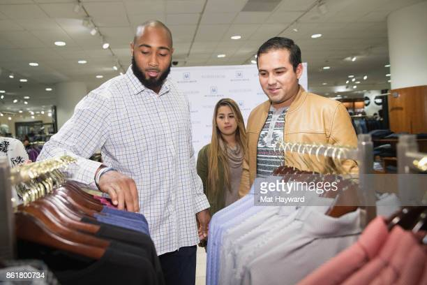 Seattle Seahawks linebacker KJ Wright shops with customers of MizzenMain at Nordsrom on October 15 2017 in Seattle Washington