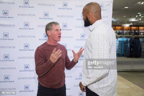 Seattle Seahawks linebacker KJ Wright visits with customers of MizzenMain at Nordsrom on October 15 2017 in Seattle Washington