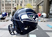 Seattle Seahawks NFL football helmet is on display in Pioneer Court to commemorate the NFL Draft 2015 in Chicago on April 30 2015 in Chicago Illinois