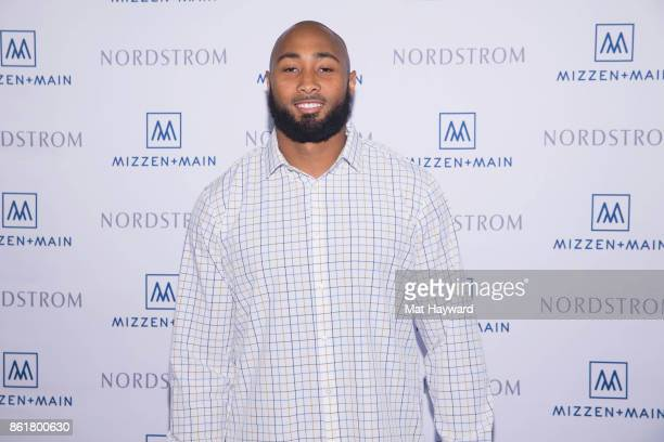 Seattle Seahawks outside linebacker KJ Wright visits with customers form MizzenMain at Nordsrom on October 15 2017 in Seattle Washington
