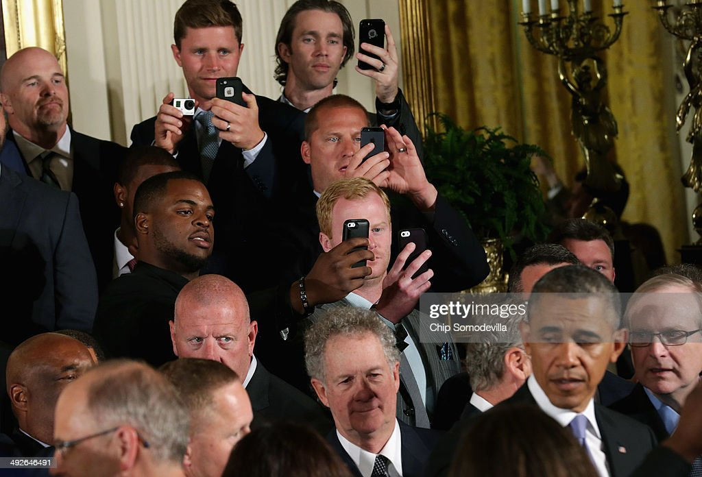 Seattle Seahawks players take photographs of U.S. President <a gi-track='captionPersonalityLinkClicked' href=/galleries/search?phrase=Barack+Obama&family=editorial&specificpeople=203260 ng-click='$event.stopPropagation()'>Barack Obama</a> during a ceremony honoring the players, coaches and executives of the Super Bowl XLVIII champions in the East Room of the White House May 21, 2014 in Washington, DC. Obama honored the Seahawks and their 43-8 win over the Denver Broncos last February.