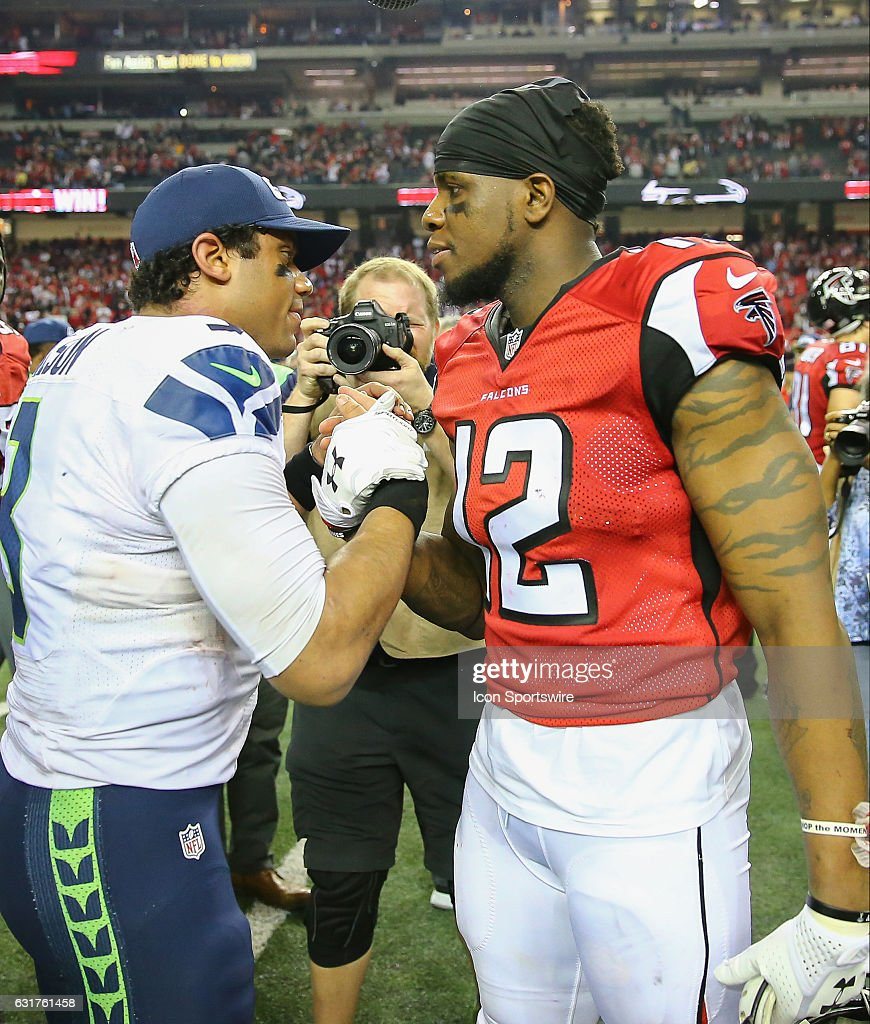 Seattle Seahawks quarterback Russell Wilson (3) and Atlanta Falcons wide receiver Mohamed Sanu (12) shake hands after the NFC Divisional Playoff game between the Seattle Seahawks and the Atlanta Falcons on January 14, 2017, at the Georgia Dome in Atlanta, Georgia. The Falcons beat the Seahawks 36-20.
