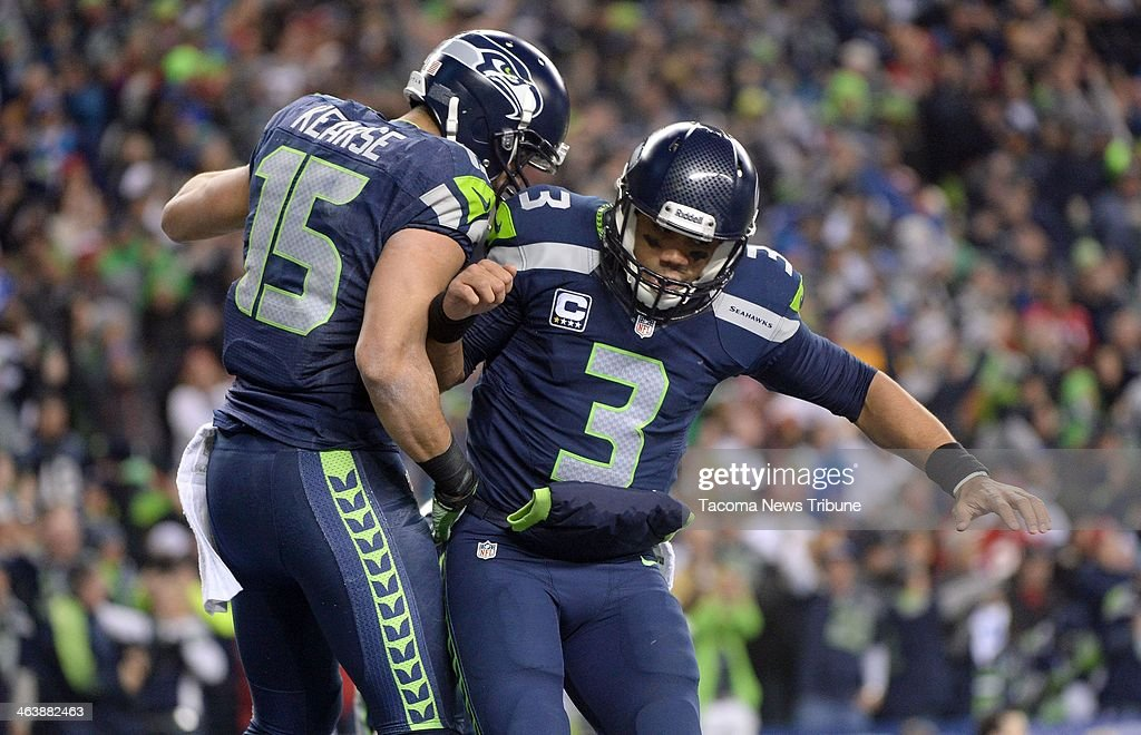 Seattle Seahawks quarterback Russell Wilson and Seahawks wide receiver Jermaine Kearse celebrate a go-ahead touchdown in the fourth quarter against the San Francisco 49ers during the NFC championship game at CenturyLink Field in Seattle on Sunday, Jan. 19, 2014. The Seattle Seahawks defeated the San Francisco 49ers, 23-17.