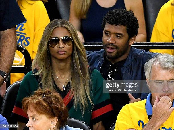 Seattle Seahawks quarterback Russell Wilson and singer Ciara attend Game 7 of the 2016 NBA Finals between the Golden State Warriors and the Cleveland...