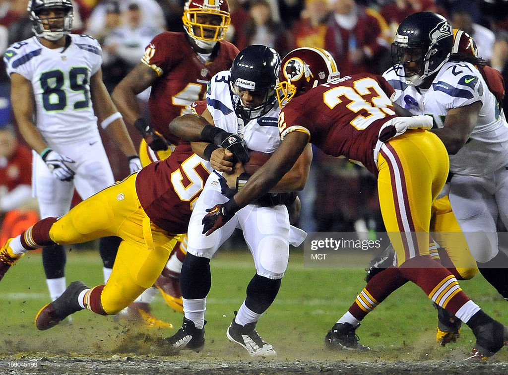 Seattle Seahawks quarterback Russell Wilson (3) gets tackled after scrambling for a gain against the Washington Redskins in the second quarter of an NFC wild-card playoff game at FedEx Field in Landover, Maryland, Sunday, January 6, 2012.