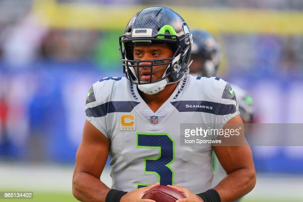 Seattle Seahawks quarterback Russell Wilson warms up prior to the National Football League game between the New York Giants and the Seattle Seahawks...
