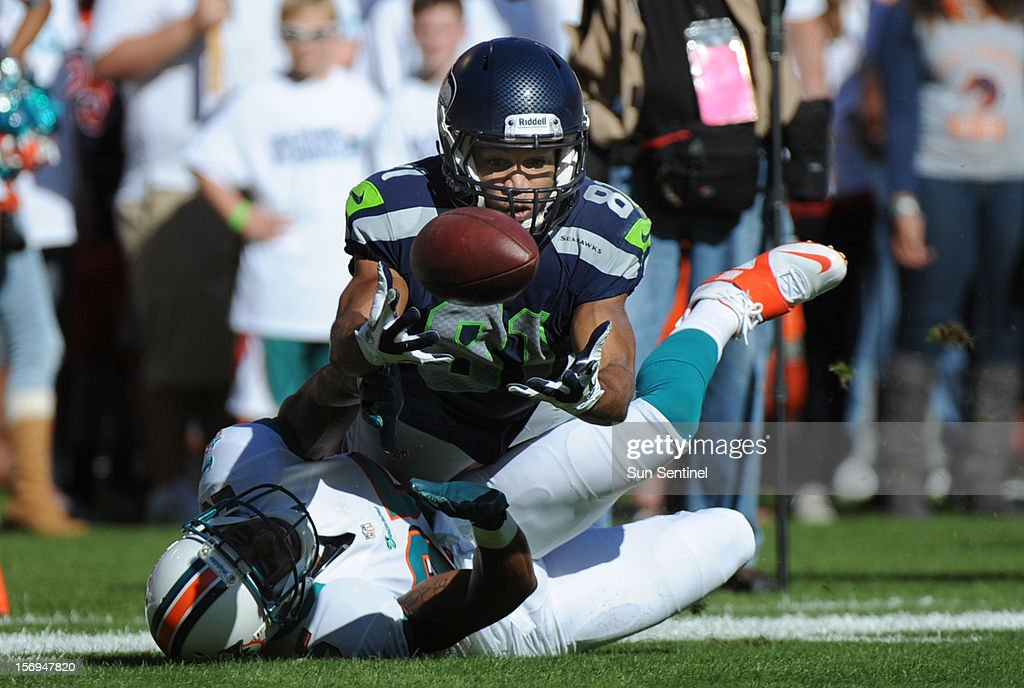 Seattle Seahawks receiver Golden Tate catches a pass over Miami Dolphins' R. J. Stanford in the second quarter at Sun Life Stadium in Miami Gardens, Florida, Sunday, November 25, 2012. The Miami Dolphins beat the Seattle Seahawks, 24-21.