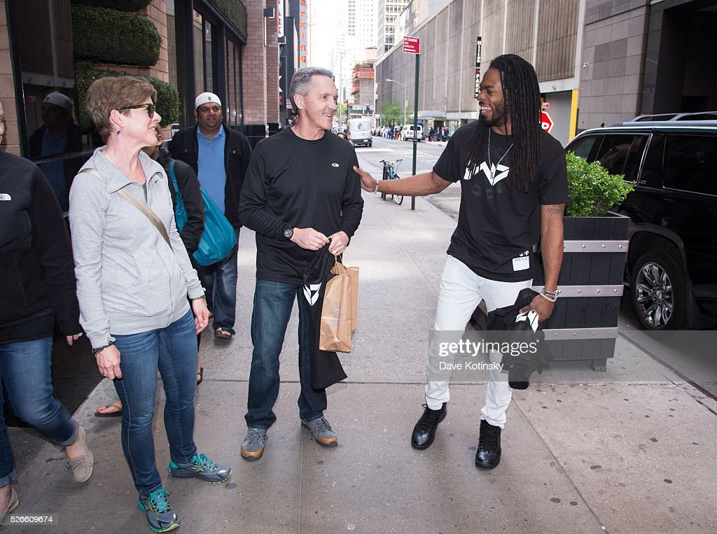 Seattle Seahawks Richard Sherman (R) greets & surprises fans near Times Square on April 30, 2016 in New York City.