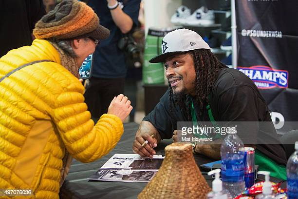 Seattle Seahawks Running Back Marshawn Lynch attends an instore appearance for the launch of BEASTMODE x PSD at Champs at Bellevue Square on November...