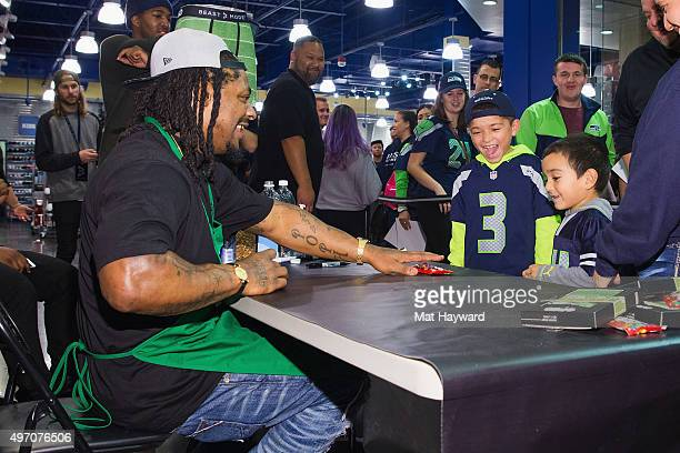 Seattle Seahawks Running Back Marshawn Lynch attends in store appearance for the launch of BEASTMODE x PSD at Champs at Bellevue Square on November...