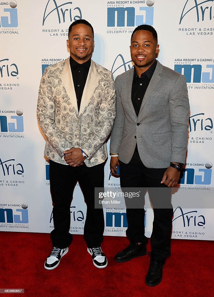 Seattle Seahawks safety Earl Thomas (L) and guest arrive at the 13th annual Michael Jordan Celebrity Invitational gala at the ARIA Resort & Casino at CityCenter on April 4, 2014 in Las Vegas, Nevada.