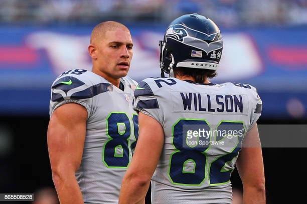 Seattle Seahawks tight end Jimmy Graham talks with teammate Seattle Seahawks tight end Luke Willson during the National Football League game between...