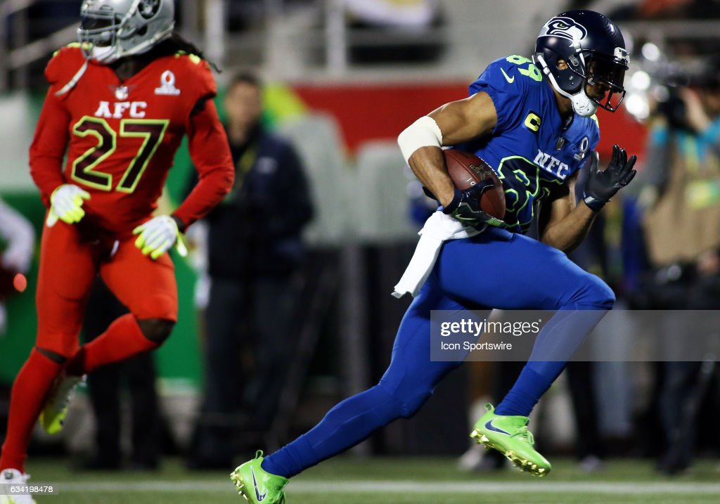 Seattle Seahawks wide receiver Doug Baldwin (89) scores a touchdown past Oakland Raiders safety Reggie Nelson (27) during the 2017 Pro Bowl at Camping World Stadium in Orlando, Florida.