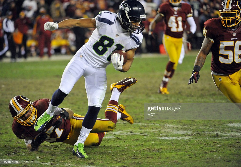 Seattle Seahawks wide receiver Golden Tate (81) works away from Washington Redskins strong safety Reed Doughty (37) in the fourth quarter of an NFC wild-card playoff game at FedEx Field in Landover, Maryland, Sunday, January 6, 2012. The Seahawks defeated the Redskins, 24-14.