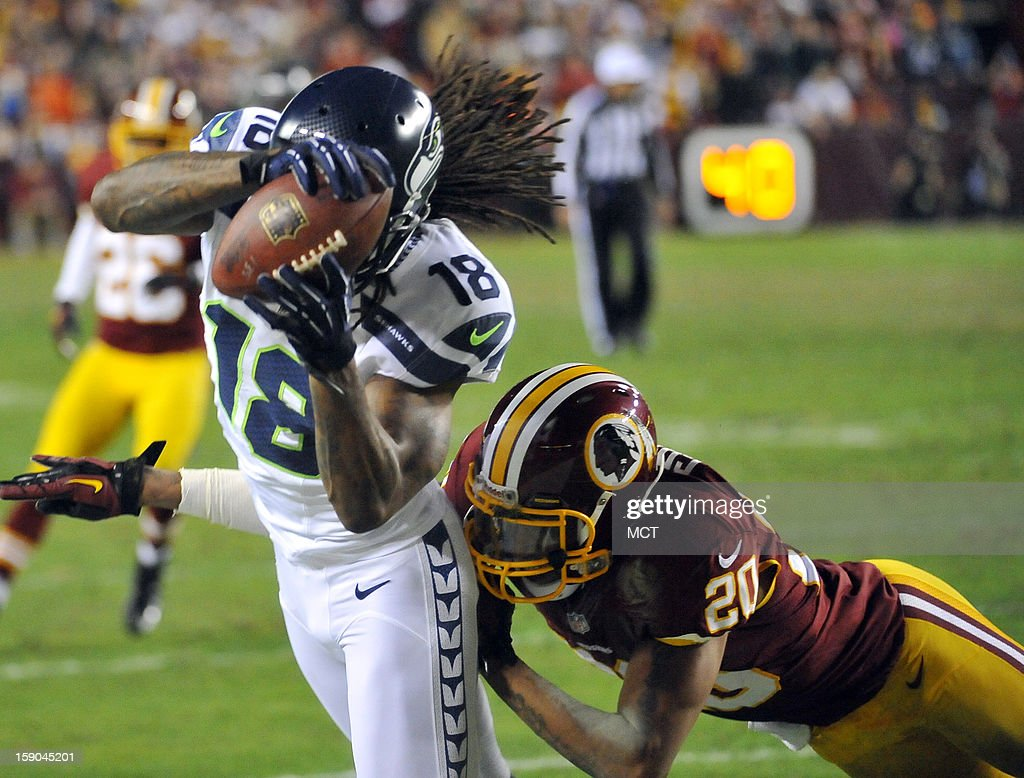 Seattle Seahawks wide receiver Sidney Rice (18) corrals a pass against Washington Redskins strong safety Cedric Griffin (20) in the second quarter of an NFC wild-card playoff game at FedEx Field in Landover, Maryland, Sunday, January 6, 2012.