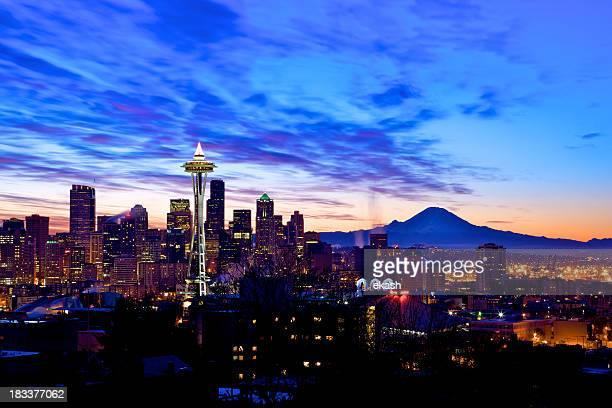 Seattle skyline lit up at sunset