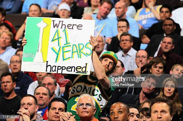 Seattle Sonics fans display signs as the support the Denver Nuggets against the Oklahoma City Thunder in Game Three of the Western Conference...