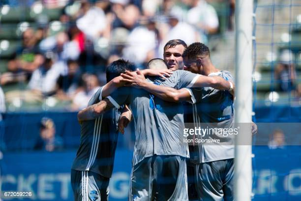 Seattle Sounders celebrate after scoring a goal in the first half during the game between the LA Galaxy and the Seattle Sounders on April 23 at...