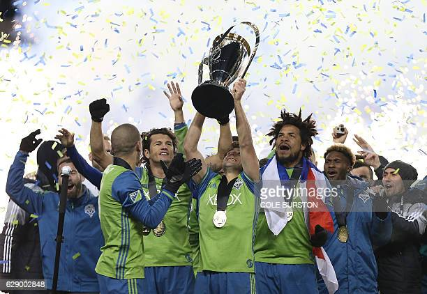 Seattle Sounders celebrate their MLS Cup final victory over Toronto FC at BMO Field on December 10 2016 in Toronto / AFP / Cole Burston