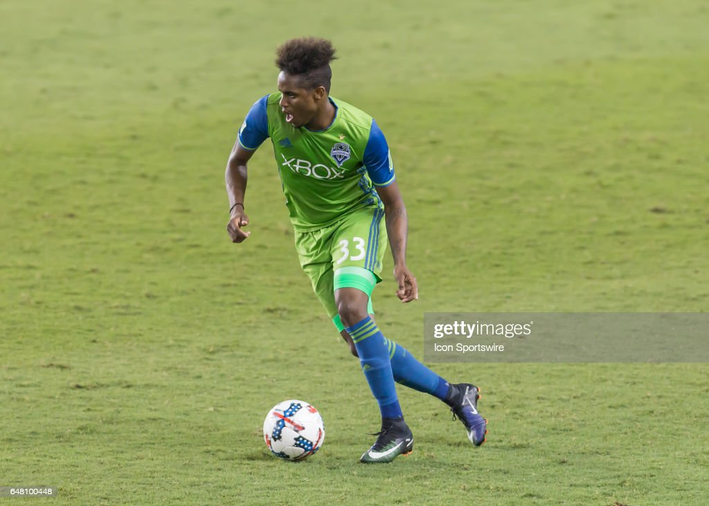 Seattle Sounders defender Joevin Jones (33) moves the ball up the pitch during the MLS opening match between the Seattle Sounders and Houston Dynamo on March 4, 2017 at BBVA Compass Stadium in Houston, Texas.