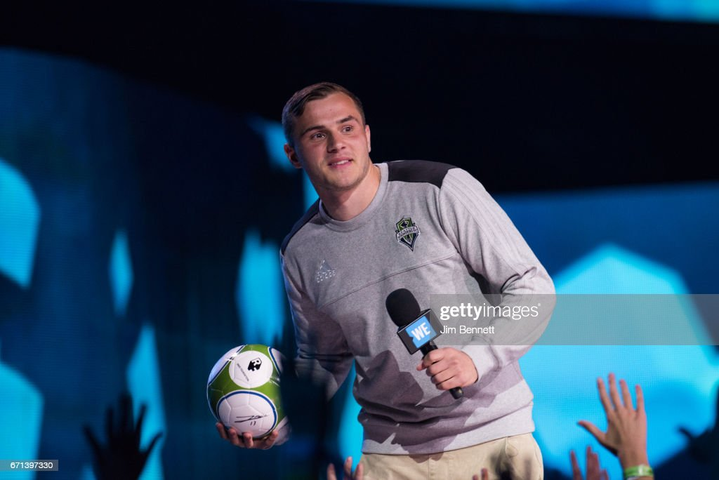Seattle Sounders forward Jordan Morris prepares to throw a soccer ball to the audience during WE Day at KeyArena on April 21, 2017 in Seattle, Washington.