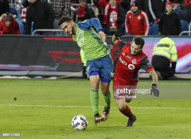 TORONTO ON DECEMBER 9 Seattle Sounders midfielder Cristian Roldan knocks Toronto FC forward Sebastian Giovinco off the ball as the Toronto FC beats...